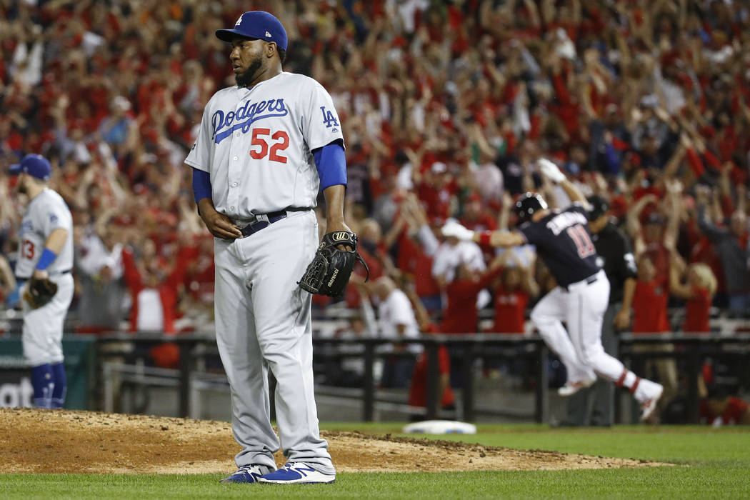 Los Angeles Dodgers relief pitcher Pedro Baez (52) looks away after giving up a three-run homer ...