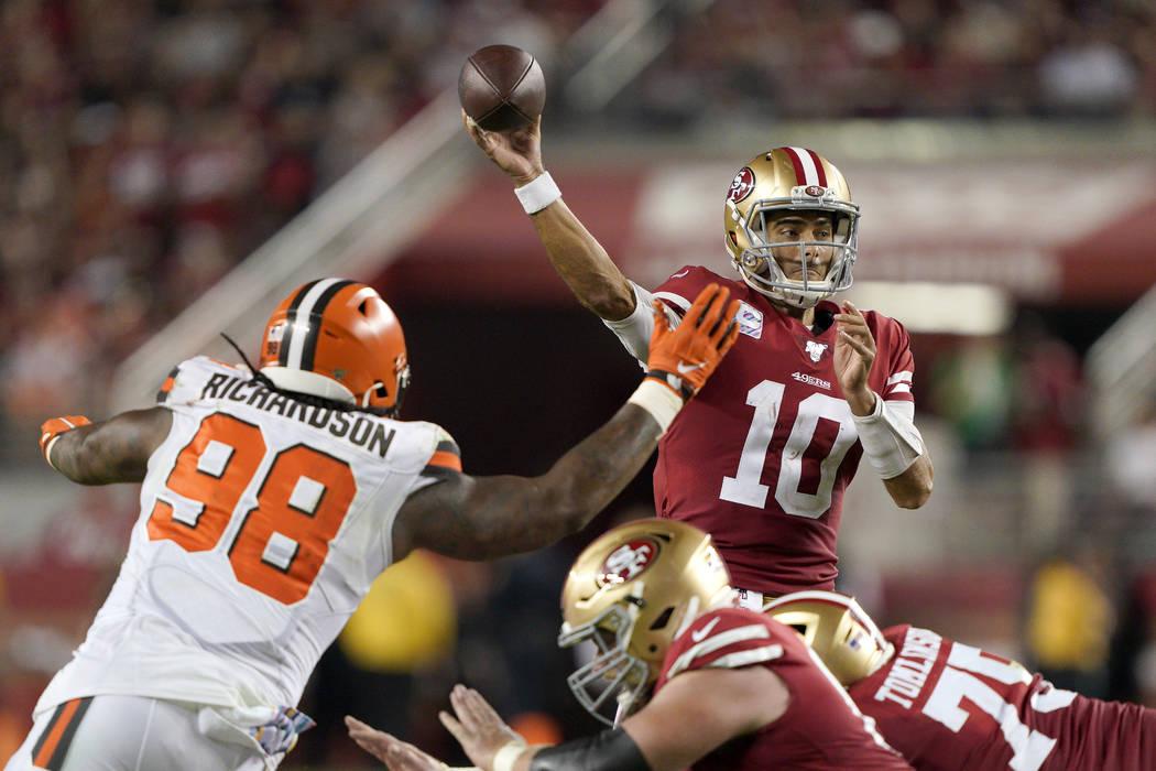 San Francisco 49ers quarterback Jimmy Garoppolo (10) passes as Cleveland Browns defensive tackl ...