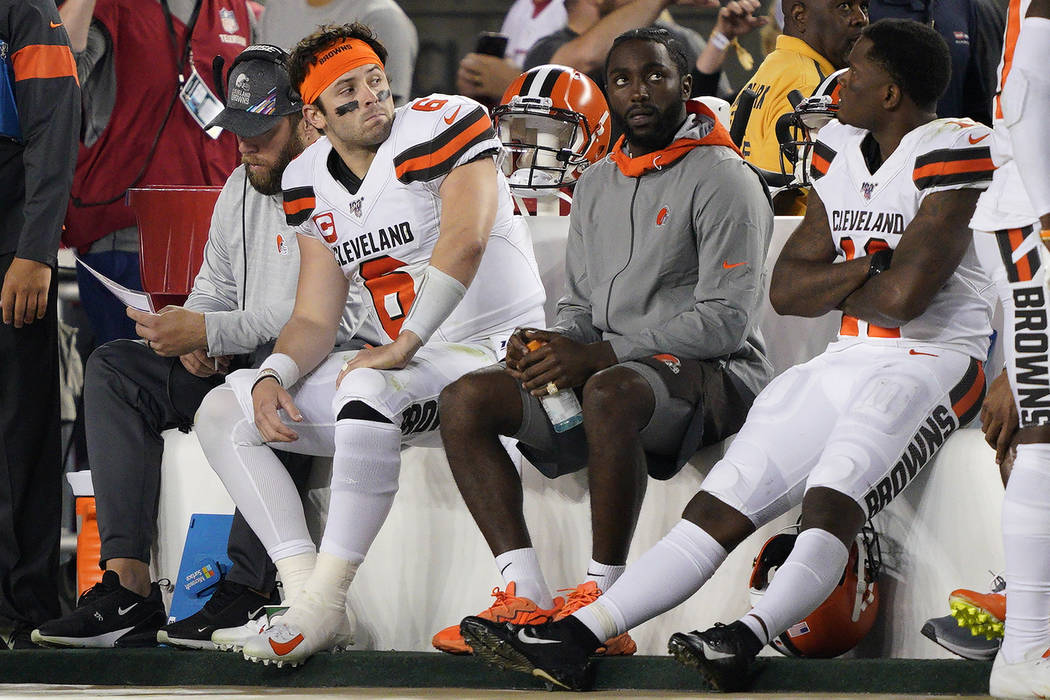 Cleveland Browns quarterback Baker Mayfield (6) sits on the bench with teammates during the sec ...