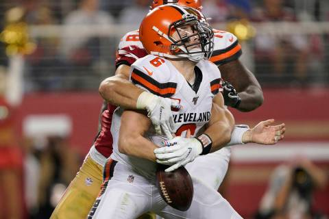 San Francisco 49ers defensive end Nick Bosa, center, sacks and forces a fumble by Cleveland Bro ...