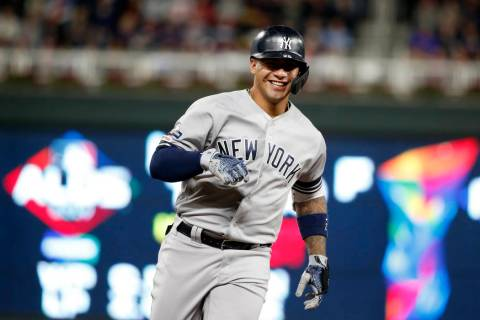 New York Yankees' Gleyber Torres celebrates as he runs the bases after hitting a home run durin ...