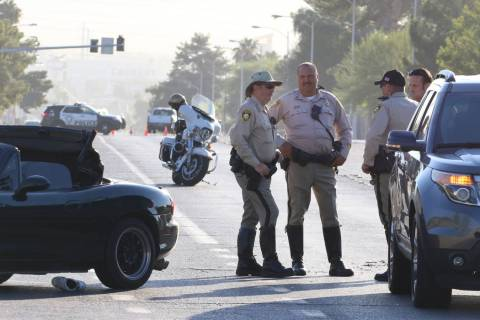 Las Vegas police investigate a serious injury crash at East Harmon Avenue and South Sandhill Ro ...