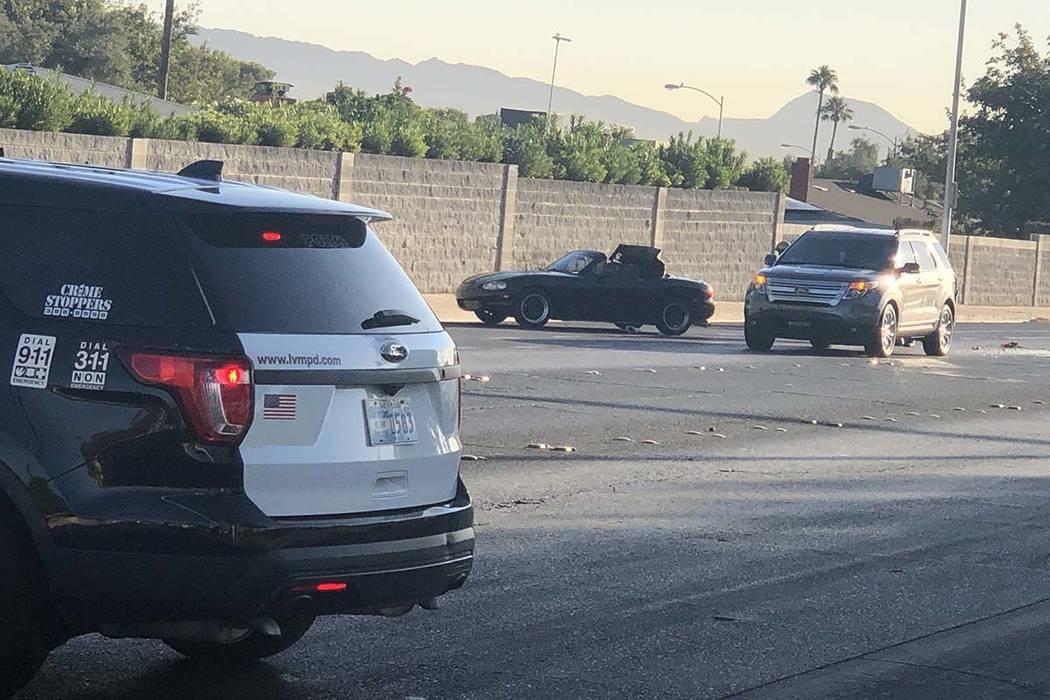 Las Vegas police investigate an injury crash at HarmonAvenueandSandhillRoad in east Las ...