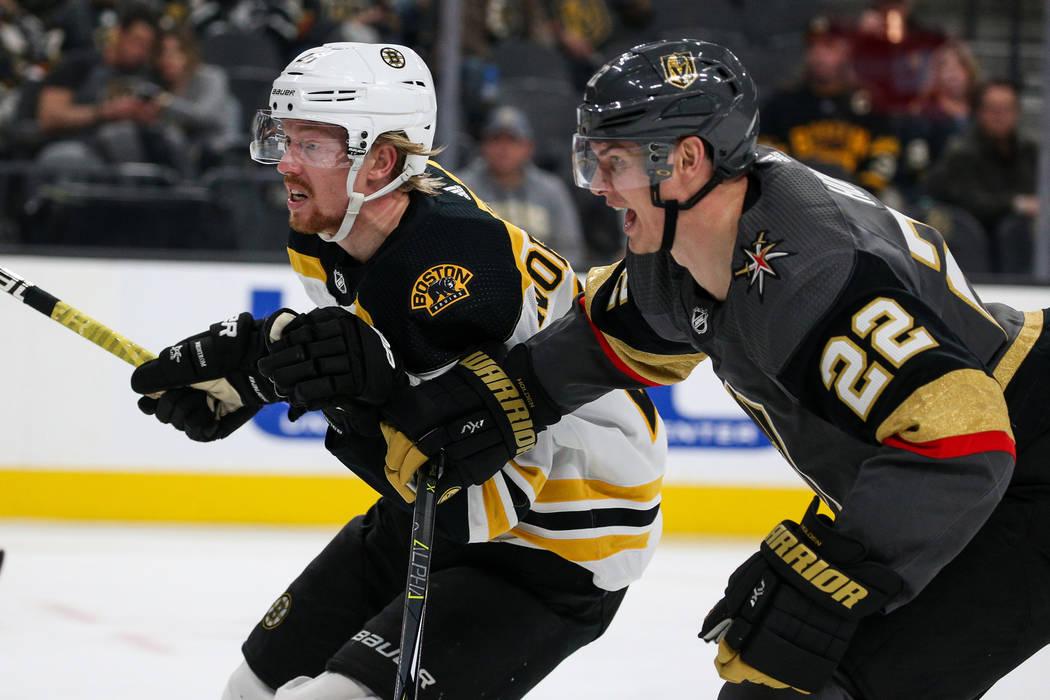 Boston Bruins center Joakim Nordstrom (20) and Vegas Golden Knights defenseman Nick Holden (22) ...