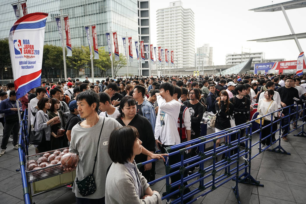 Fans wait in line to purchase team merchandise outside Saitama Super Arena in Saitama, near Tok ...