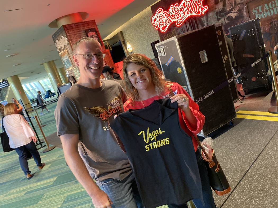 Kris and Barbie Dahl are shown with Steven Tyler's famous Vegas Strong T-shirt at Park Theater ...