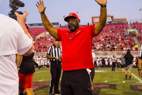Former UNLV football player Ickey Woods waves at the crowd after participating in the coin toss ...