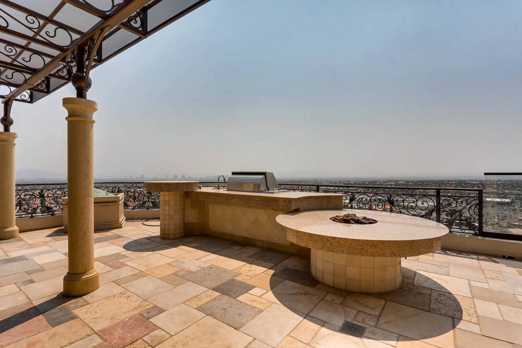 The high-rise has a built-in barbecue. (Char Luxury Real Estate)