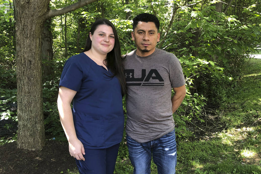 In a photo taken June 21, 2019, Alyse Sanchez and her husband, Elmer Sanchez, pose for The Asso ...