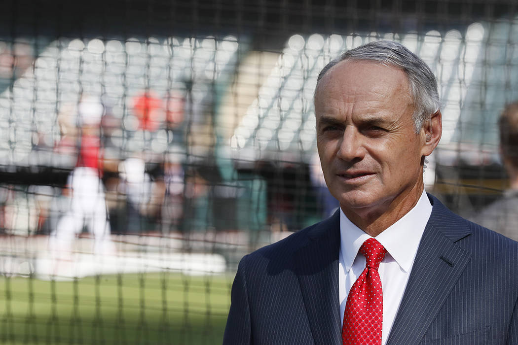 Commissioner Rob Manfred watches as the American League players warm-up for the MLB baseball Al ...