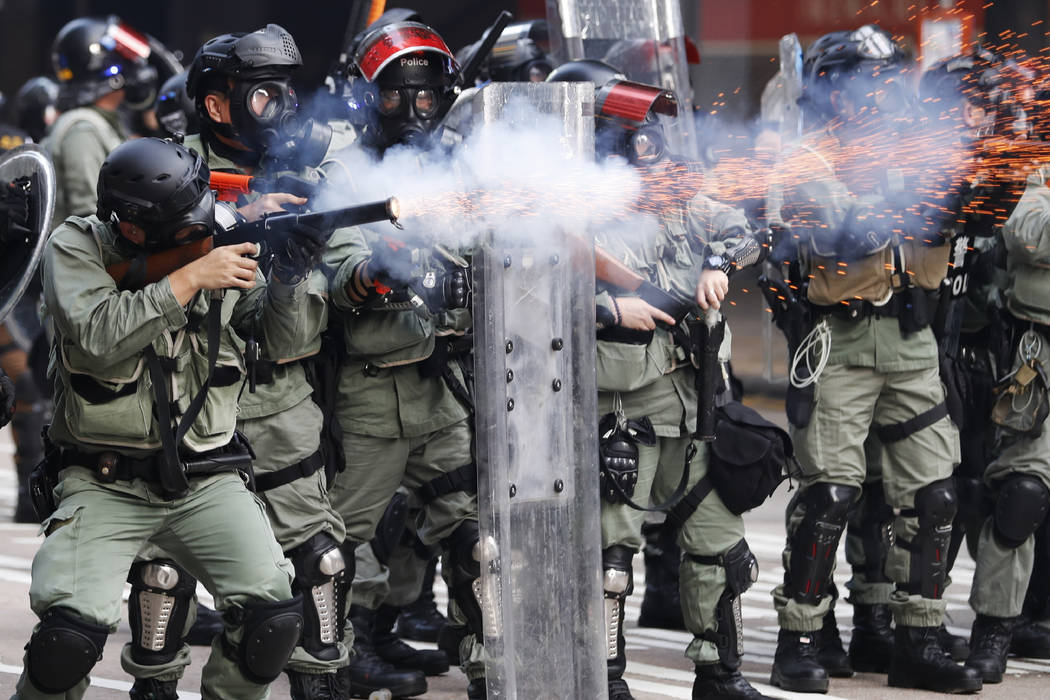 FILE - In this Oct. 1, 2019, file photo, police fire tear gas to disperse anti-government prote ...