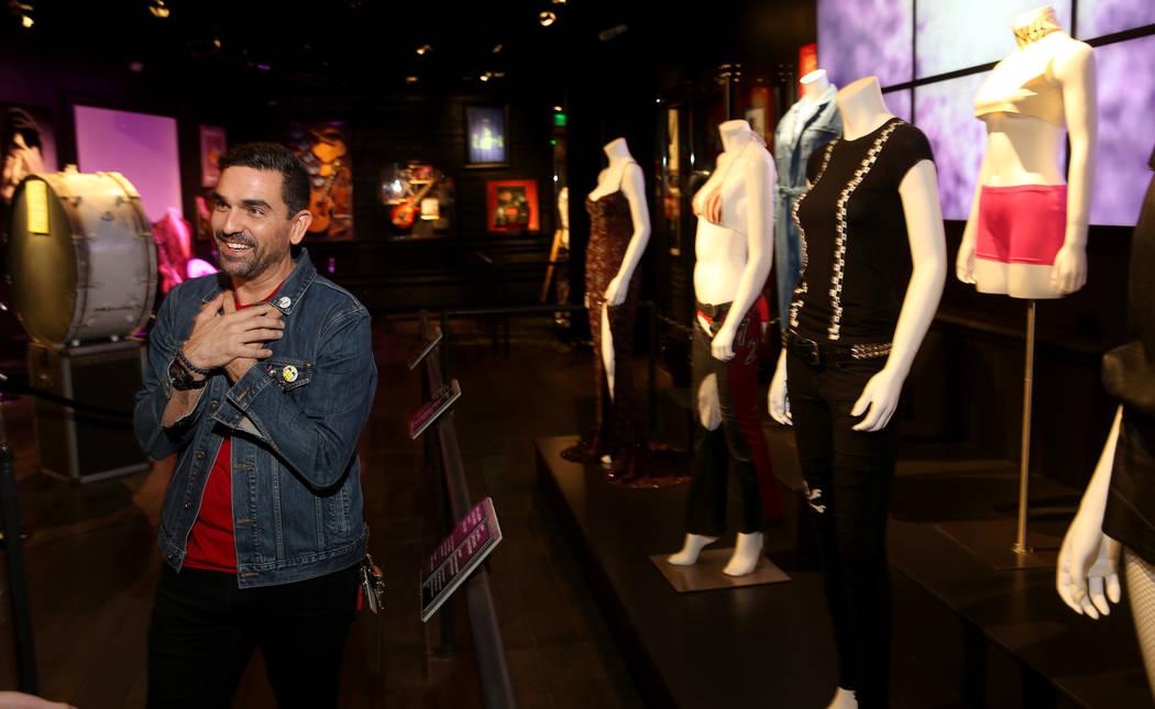 Hard Rock exhibition coordinator Beau Dobney at a new rock memorabilia exhibit at the Hard Rock ...