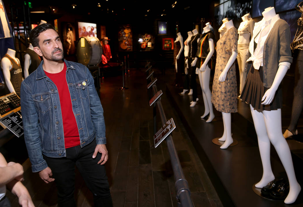 Hard Rock exhibition coordinator Beau Dobney talks about outfits of female rock stars, includin ...