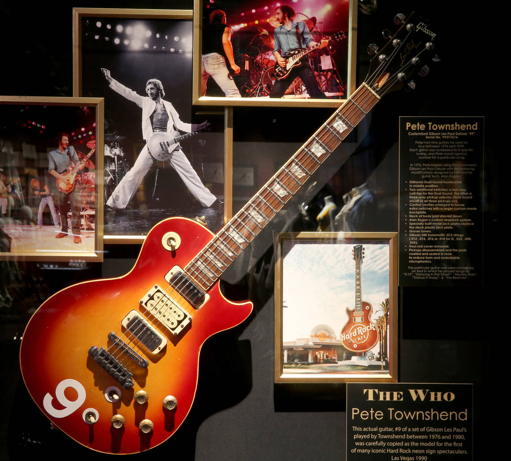 The Who's Pete Townshend's guitar used as the model for the Hard Rock neon sign at a new rock m ...