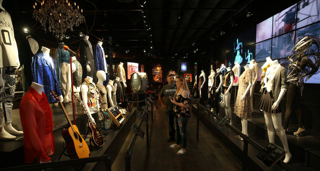 Lupe and Stefanie Cuevas, of Fresno, Calif., at a new rock memorabilia exhibit at the Hard Rock ...