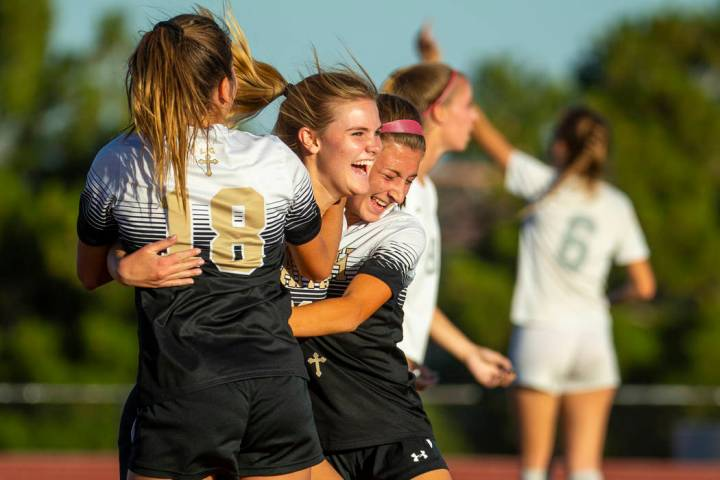 Faith Lutheran's Amelia McManus (20, center) celebrates a goal with teammates Addy Radwanski (1 ...