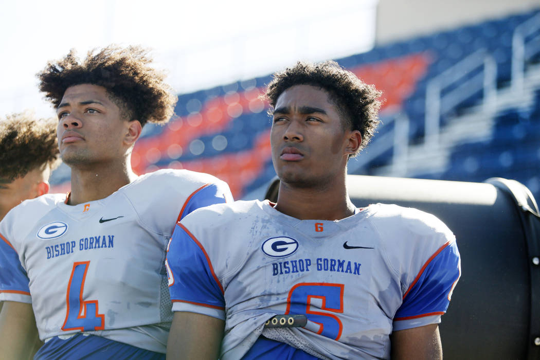 Bishop Gorman's wide receiver Rome Odunze (4), and running back Ikaika Ragsdale (6) watch a dri ...