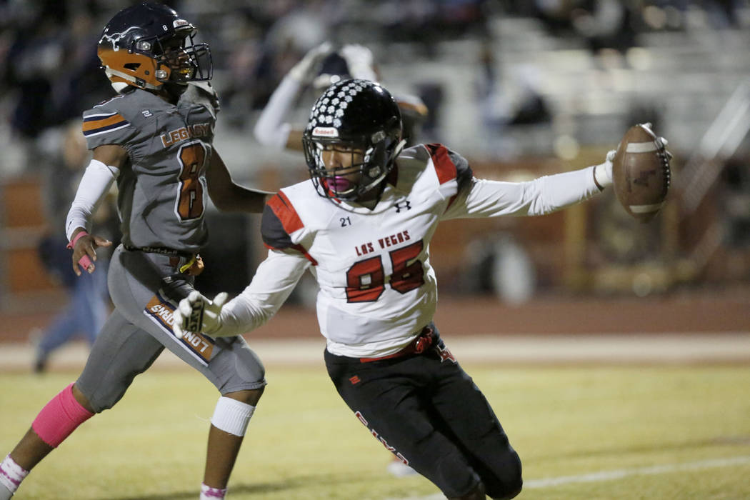 Las Vegas' Christian Flores (85) scores a touchdown  during the fourth quarter of a football ...