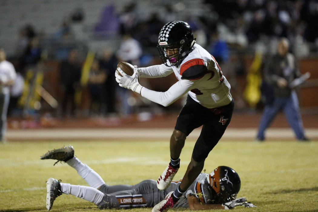 Las Vegas' Christian Flores (85) catches a pass and runs to the corner during the fourth quart ...