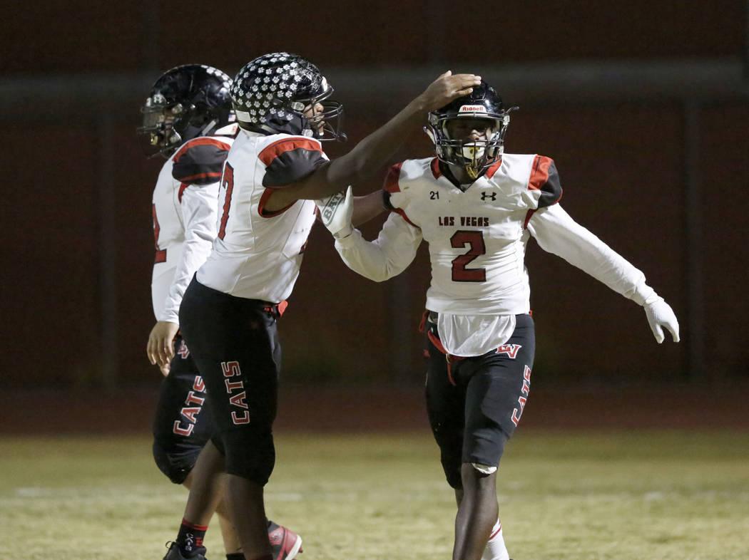 Las Vegas' Miles Davis (2) celebrate his touchdown with his teammate Anthony Coleman, left, dur ...