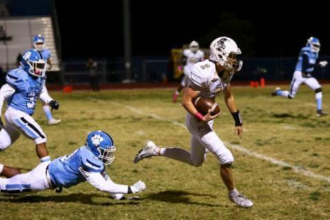 Faith Lutheran's Riley Schwartz (2) runs past Centennial's Donte Washington (3) on his way to s ...