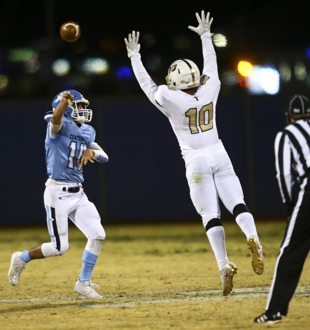 Centennial quarterback Colton Tenney (10) throws the ball over Faith Lutheran's Amani El-nawal ...