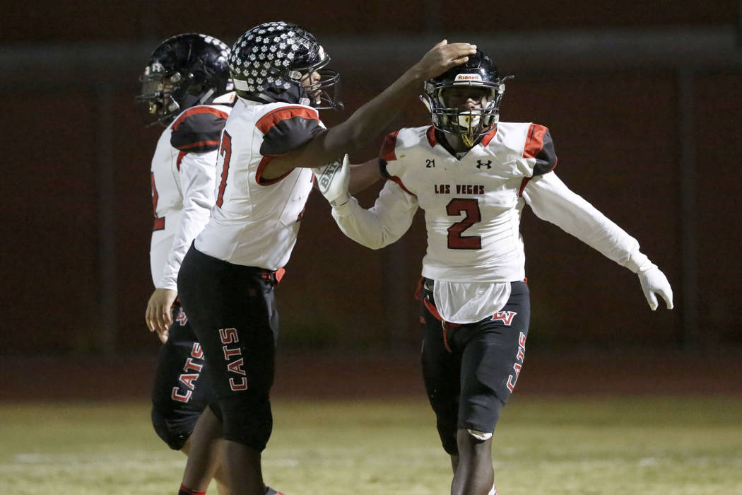 Las Vegas' Miles Davis (2) celebrate his touchdown with his teammate Anthony Coleman, left, dur ...