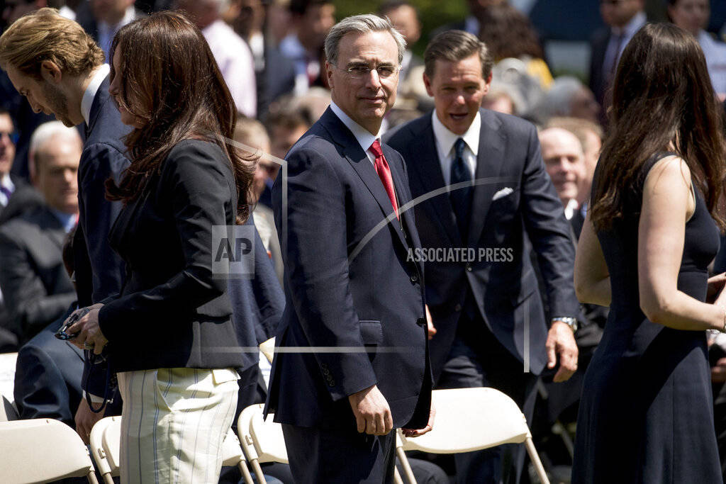 White House counsel Pat Cipollone, center, arrives for an immigration speech by President Donal ...