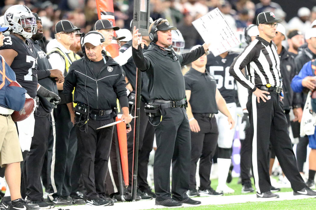 Oakland Raiders head coach Jon Gruden reacts after the referees overturn an interception by cor ...