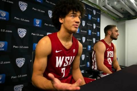 Washington State's CJ Elleby, left, and Jeff Pollard speak during the Pac-12 NCAA college baske ...