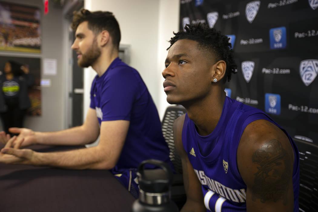 Washington's Sam Timmins, left, and Nahziah Carter speak during the Pac-12 NCAA college basketb ...