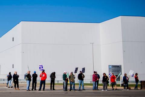 General Motors' Flint Assembly Plant employees line the street with picket signs during the nat ...