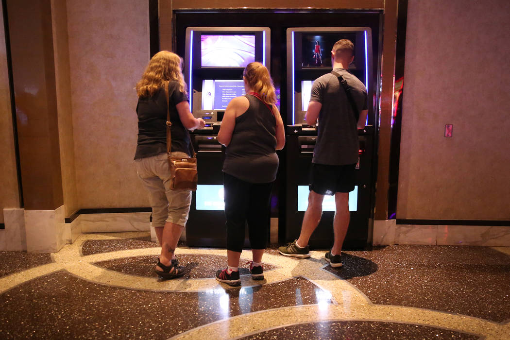 People use redemption kiosks at the Cosmopolitan hotel-casino in Las Vegas, Tuesday, Oct. 8, 20 ...