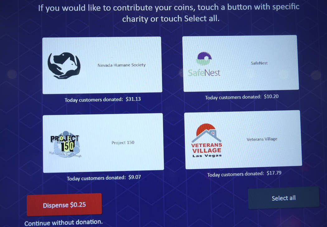 The screen of a redemption kiosk shows charities to donate coins to at the Cosmopolitan hotel-c ...