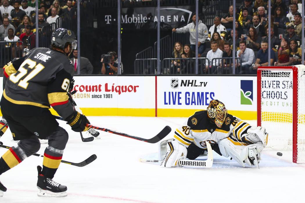 Golden Knights' Mark Stone (61) scores a goal past Boston Bruins goaltender Tuukka Rask (40) du ...