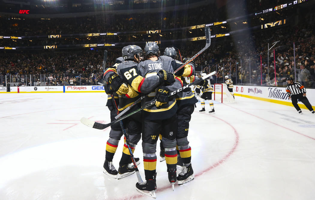 Golden Knights' Mark Stone, center, celebrates his goal with teammates during the first period ...