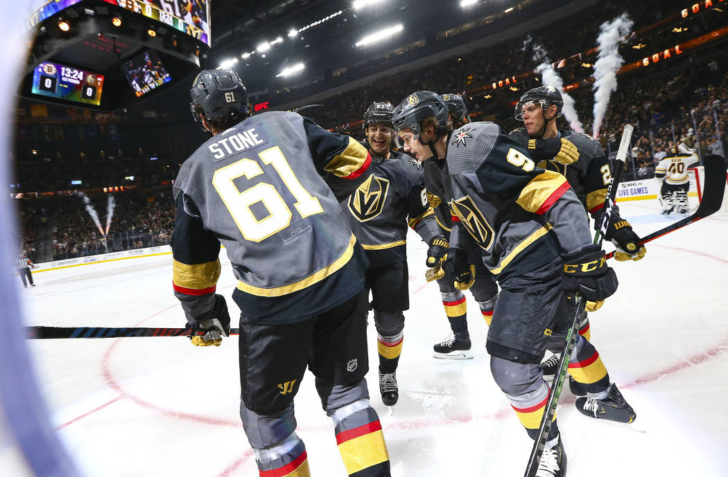 Golden Knights' Mark Stone (61) celebrates his goal with teammates Max Pacioretty, center, and ...