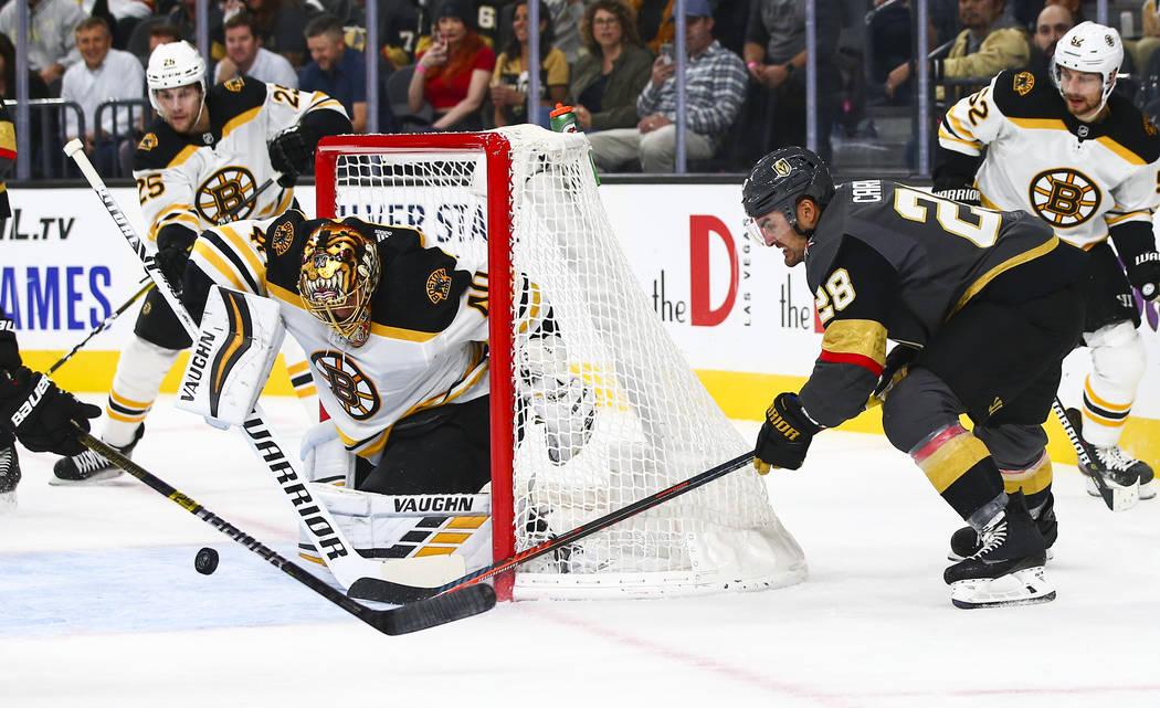Boston Bruins goaltender Tuukka Rask (40) blocks a shot from Golden Knights' William Carrier (2 ...
