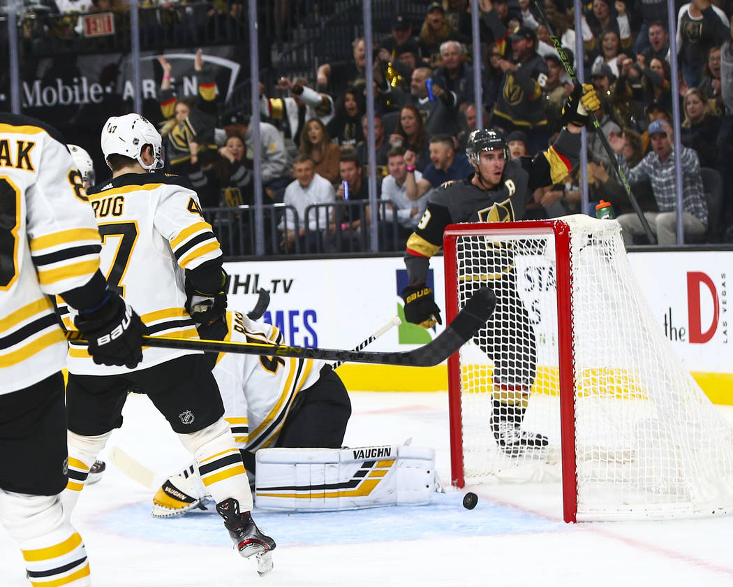 Golden Knights' Reilly Smith, upper right, celebrates his goal against the Boston Bruins during ...