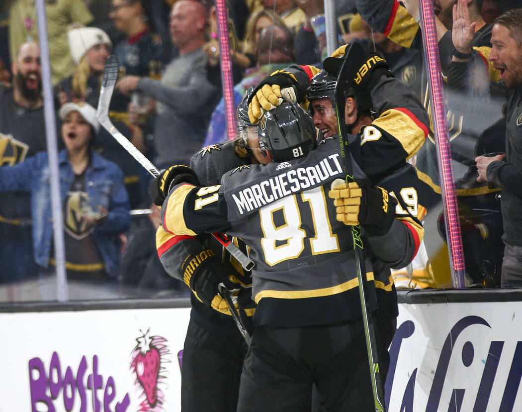 Golden Knights' Reilly Smith, right, celebrates his goal against the Boston Bruins with teammat ...