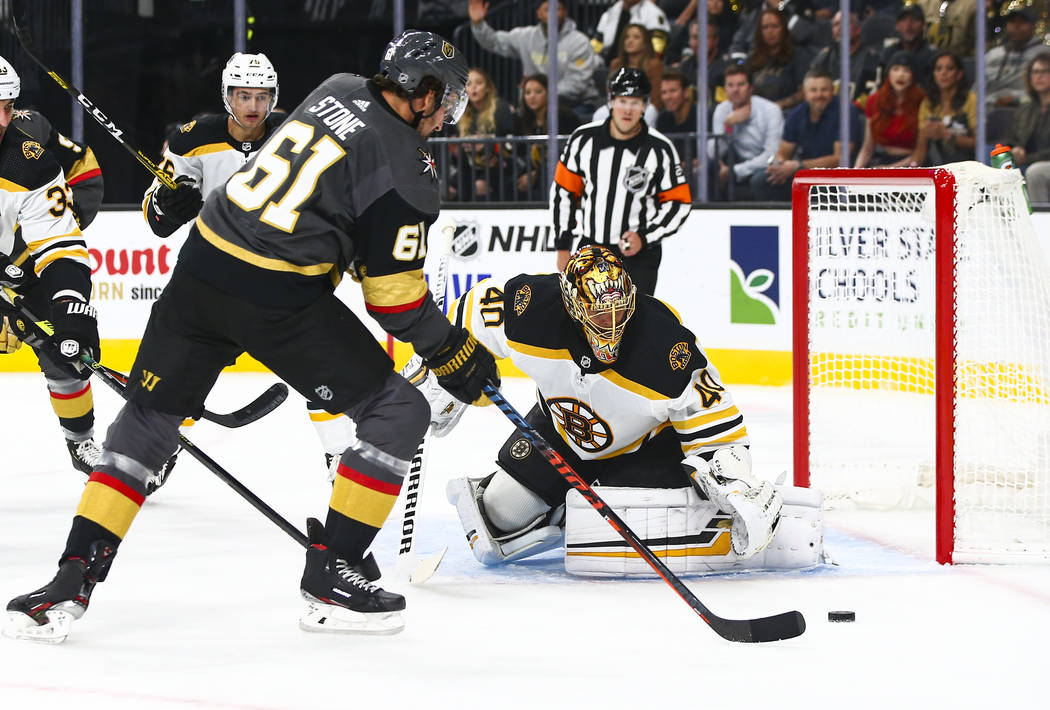 Golden Knights' Mark Stone (61) tries to get the puck past Boston Bruins goaltender Tuukka Rask ...