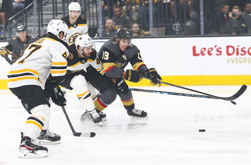 Golden Knights' Reilly Smith (19) battles for the puck against Boston Bruins' David Krejci (46) ...