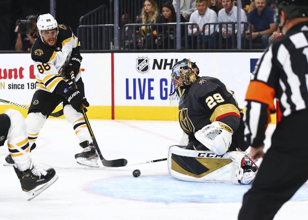 Golden Knights goaltender Marc-Andre Fleury (29) blocks a shot from Boston Bruins' David Pastrn ...