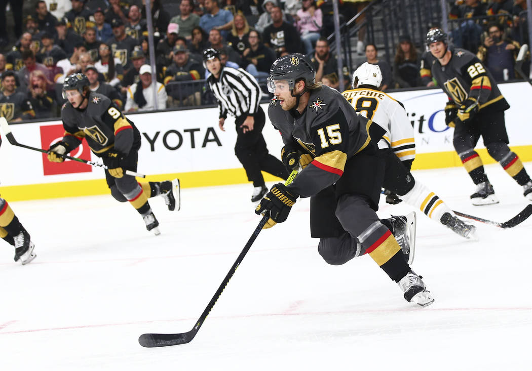Golden Knights' Jon Merrill (15) skates with the puck during the second period of an NHL hockey ...