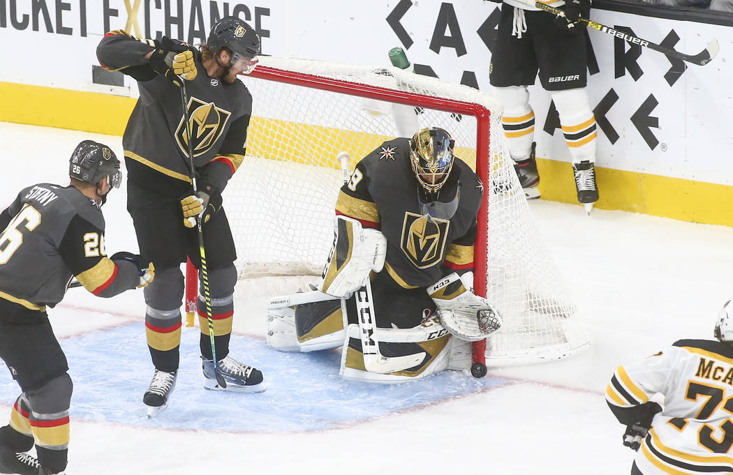 Golden Knights goaltender Marc-Andre Fleury (29) blocks a shot from the Boston Bruins during th ...