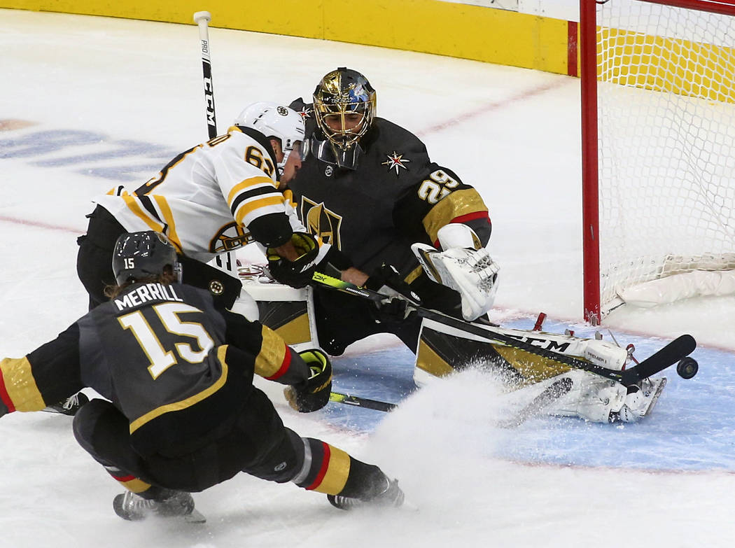 Golden Knights goaltender Marc-Andre Fleury (29) blocks a shot from Boston Bruins' Brad Marchan ...
