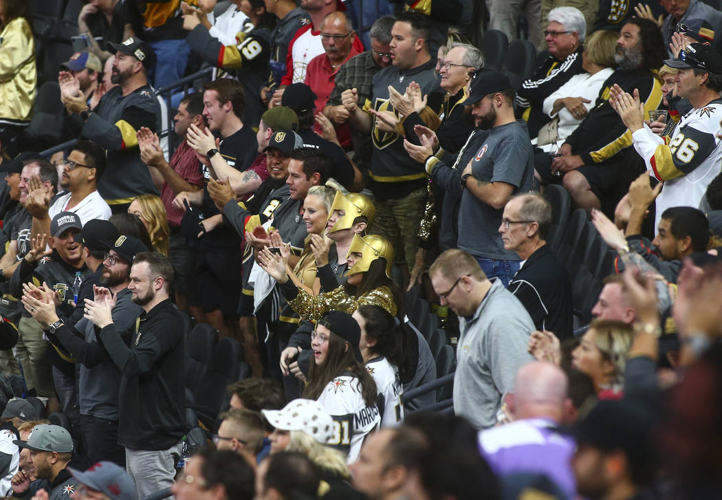 Golden Knights fans celebrate a goal against the Boston Bruins during the third period of an NH ...