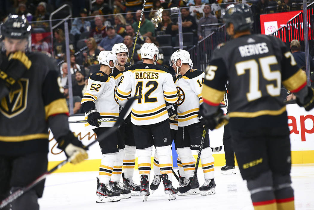 The Boston Bruins celebrate after scoring against the Golden Knights during the second period o ...