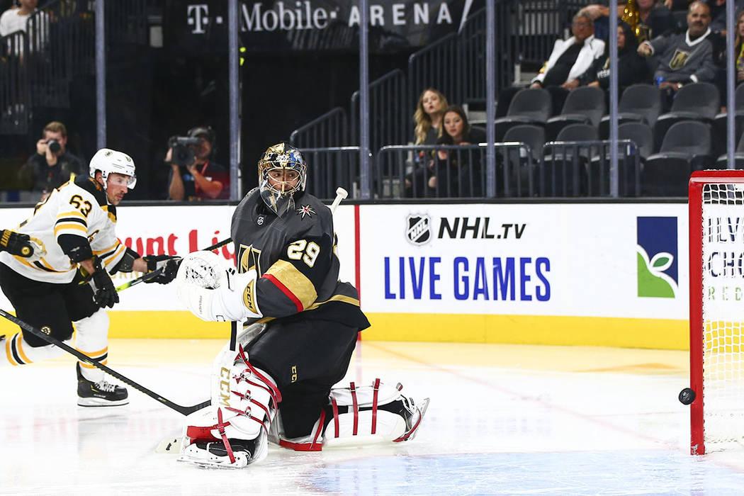 Boston Bruins' Brad Marchand (63) scores a goal past Golden Knights goaltender Marc-Andre Fleur ...