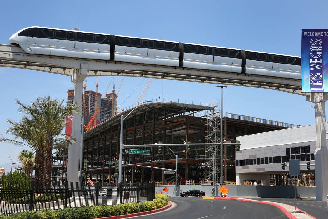 The Las Vegas Monorail runs past the Las Vegas Convention Center expansion on Tuesday, July 9, ...